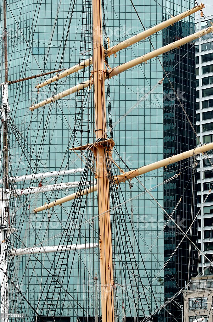 Masts of old sailing vessels and office buildings in NYC royalty-free stock photo