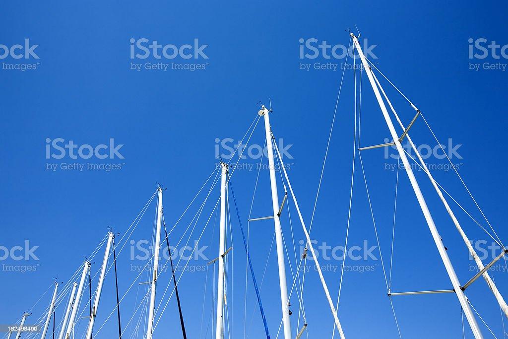 Masts of sailboats in marina bay stock photo