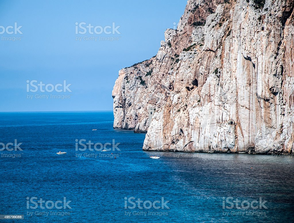 Masua's sea stack daily, some boats in summertime (Sardinia) stock photo