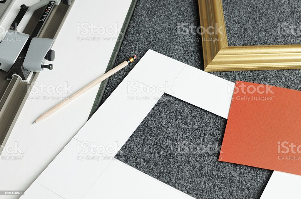 Mat board cutting for picture framing royalty-free stock photo