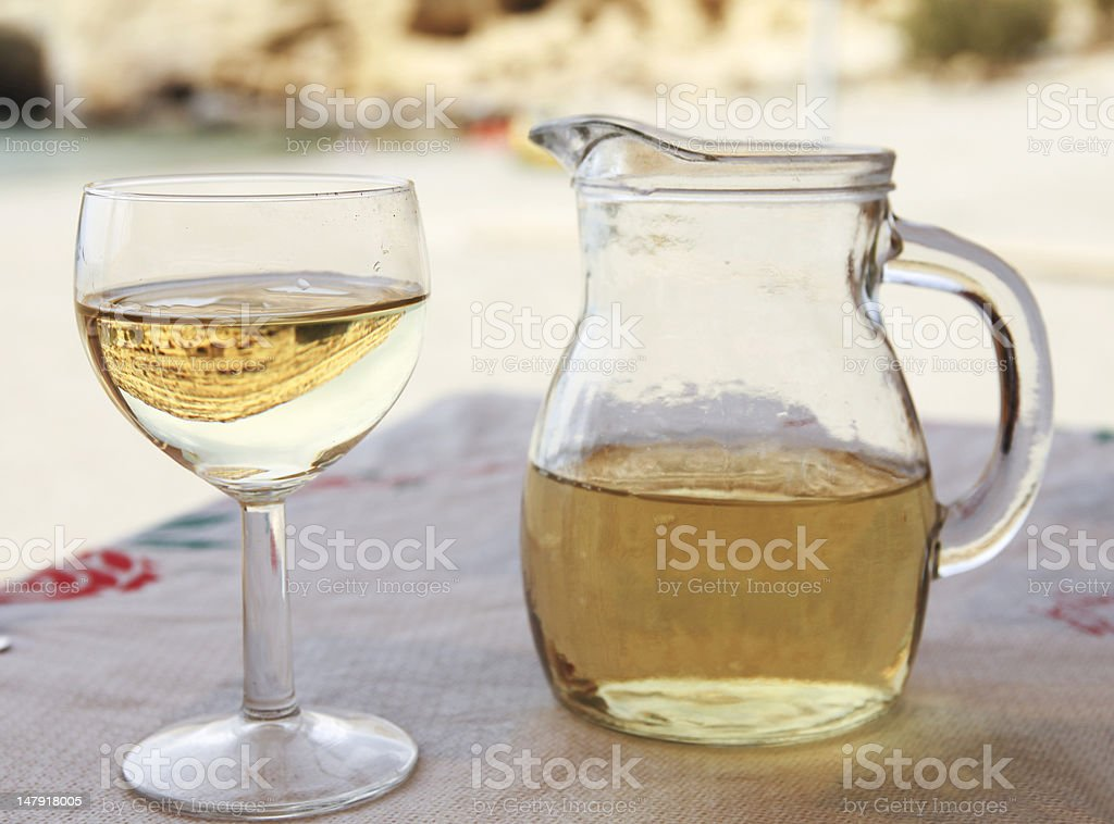 Matala reflection in white wine royalty-free stock photo