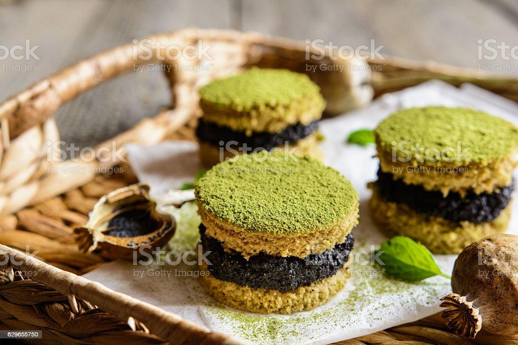 Matcha cakes with poppy seeds stock photo
