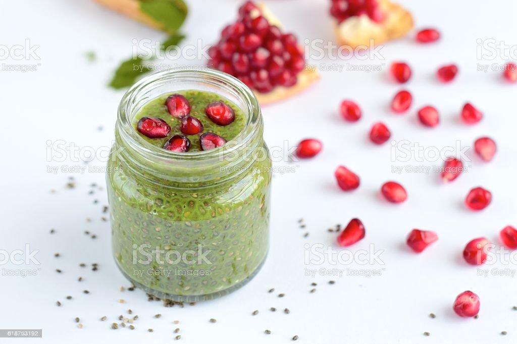 Matcha chia seed pudding with pomegranate stock photo