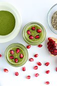 Matcha chia seed pudding with pomegranate seeds