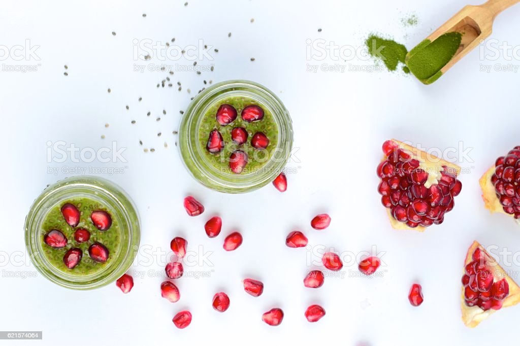 Matcha chia seed pudding with pomegranate seeds stock photo