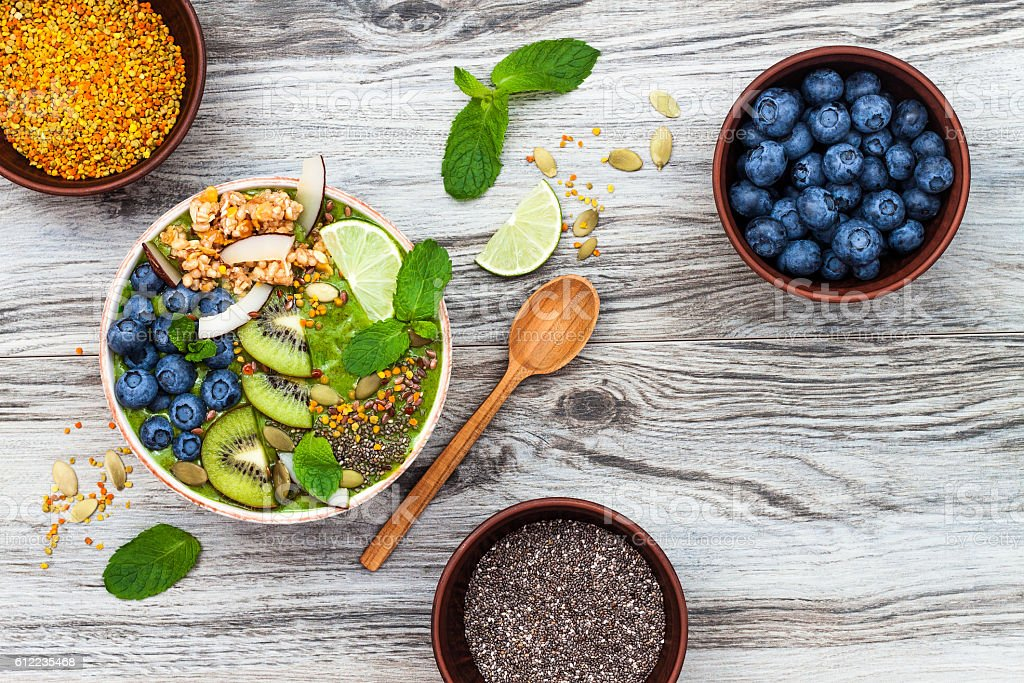 Matcha green tea breakfast superfoods smoothies bowl with chia seeds stock photo
