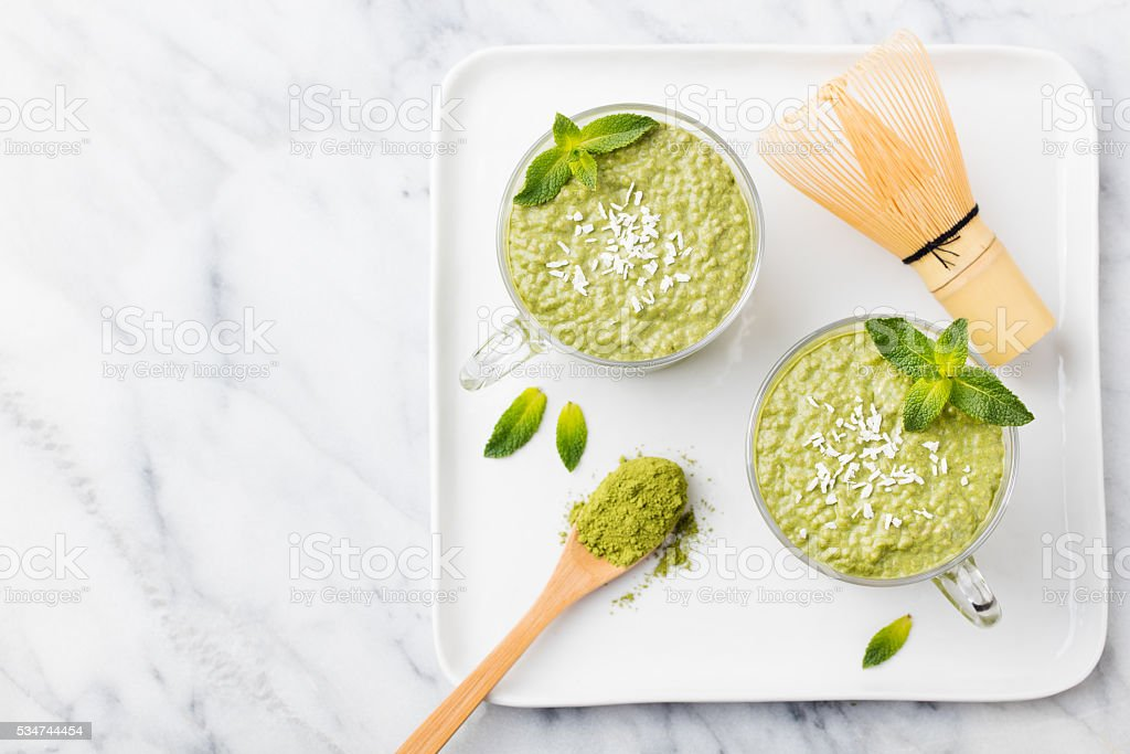 Matcha green tea chia seed pudding, dessert with coconut stock photo