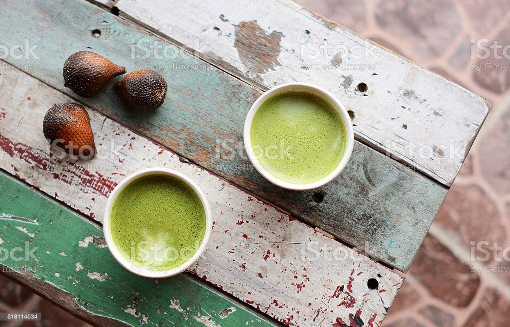 Matcha green tea latte on a table stock photo