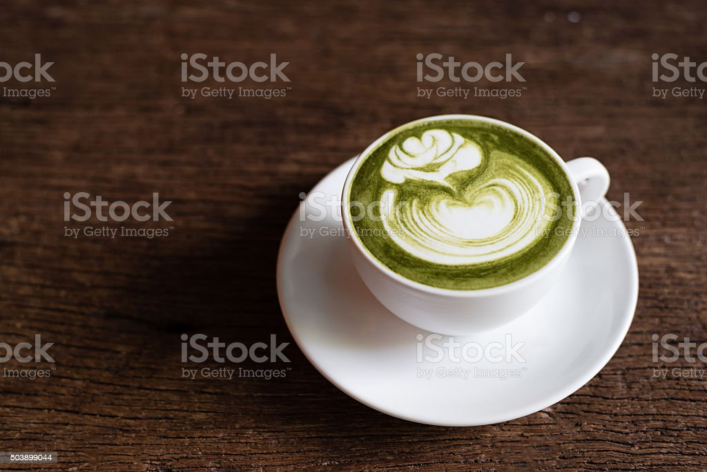 matcha green tea latte with latte art in rose pattern stock photo