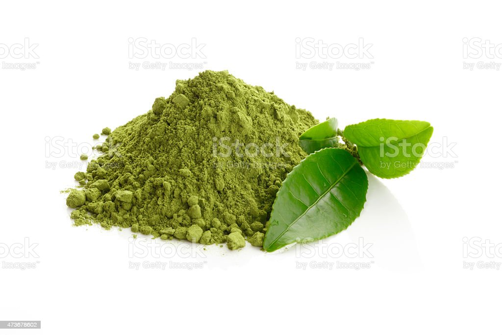 Matcha/ Green Tea powder and fresh green tea leaves stock photo