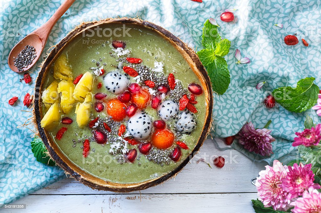 matcha green tea smoothie bowl with exotics fruits stock photo