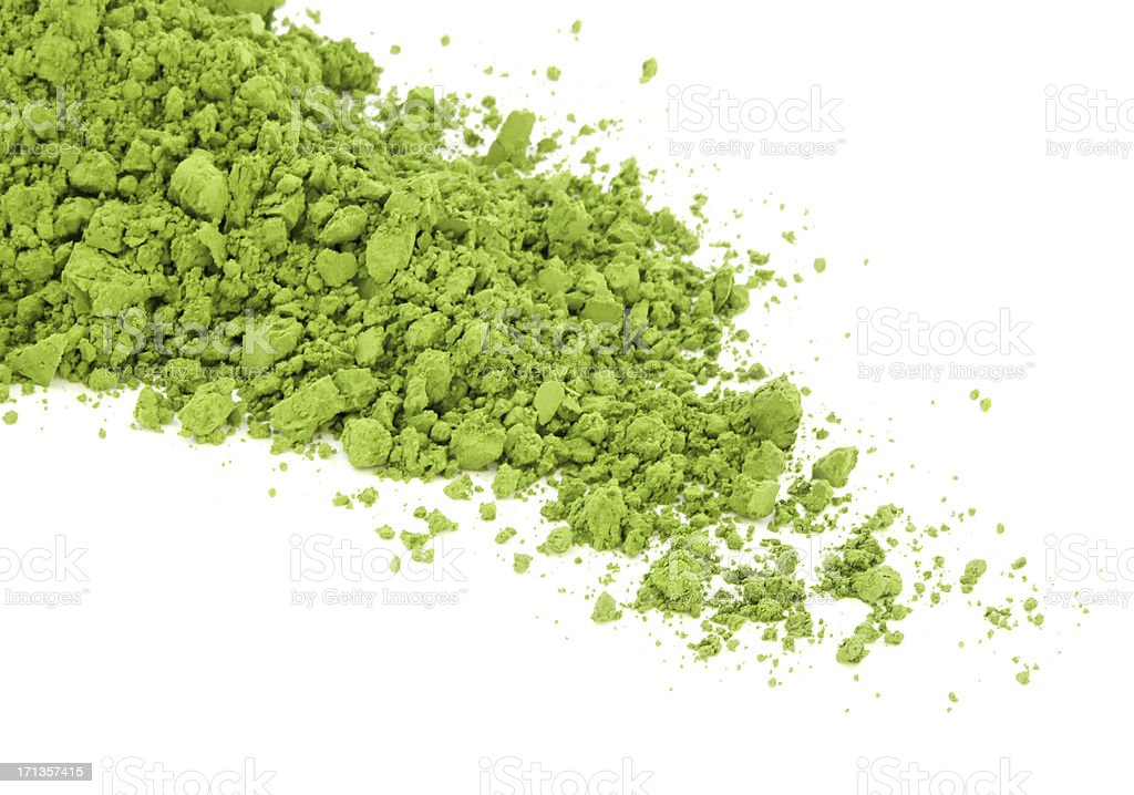 Matcha green tea spilt over the white surface stock photo