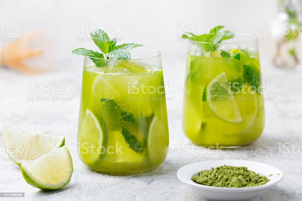 Matcha iced green tea with lime and fresh mint stock photo