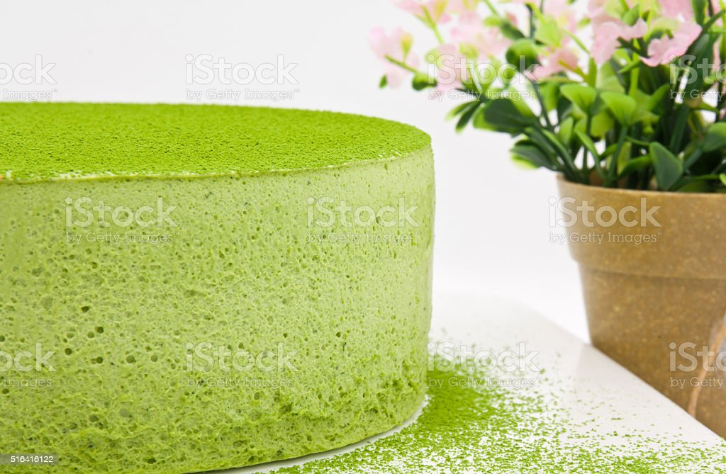 Matcha mousse cake with strawcherry stock photo