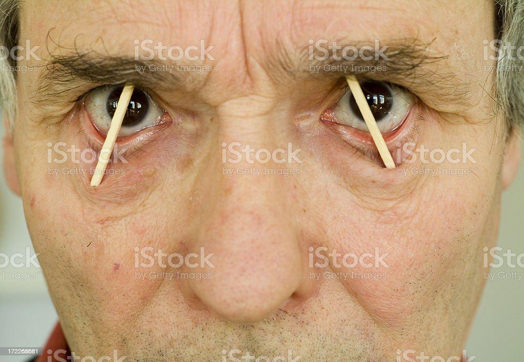 Matches between eyelids of senior man keeping awake royalty-free stock photo