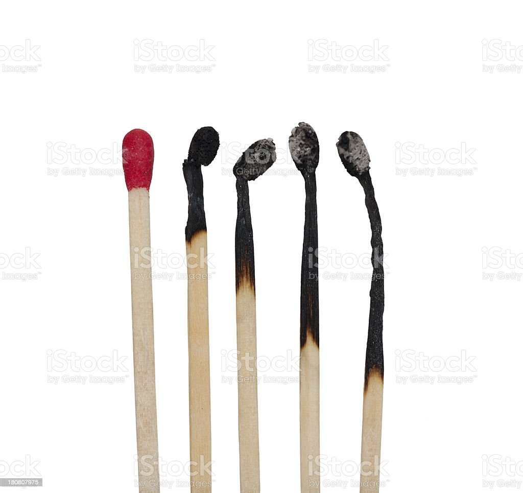 matches row with four burnt in different stages one unburnt stock photo