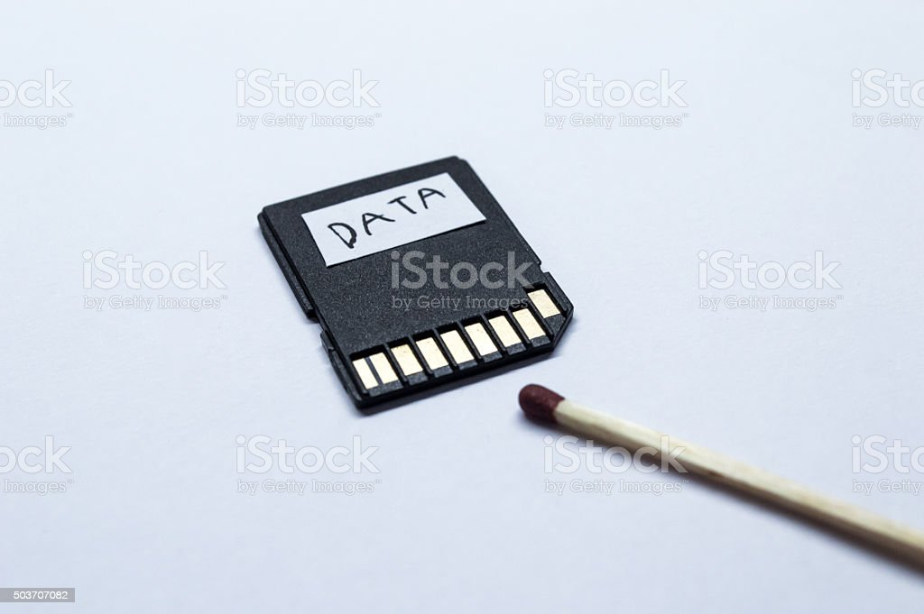 Matchstick Near a Memory/SD 'Data' Card royalty-free stock photo