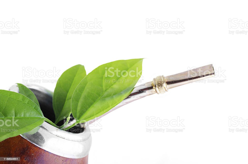 Mate Cup with yerba green leafs stock photo