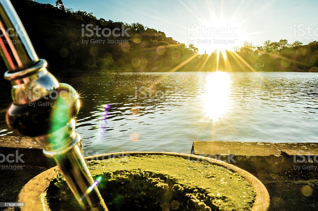 Mate the pond with sun stock photo