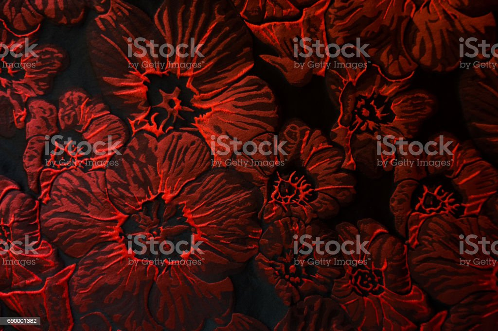 Matelasse jacquard fabric with bright red floral pattern stock photo