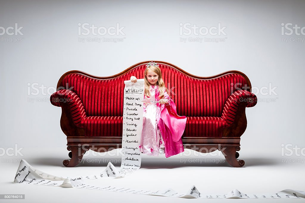 Material Girl - Princess Wish Humor Child Sofa Consumerism stock photo