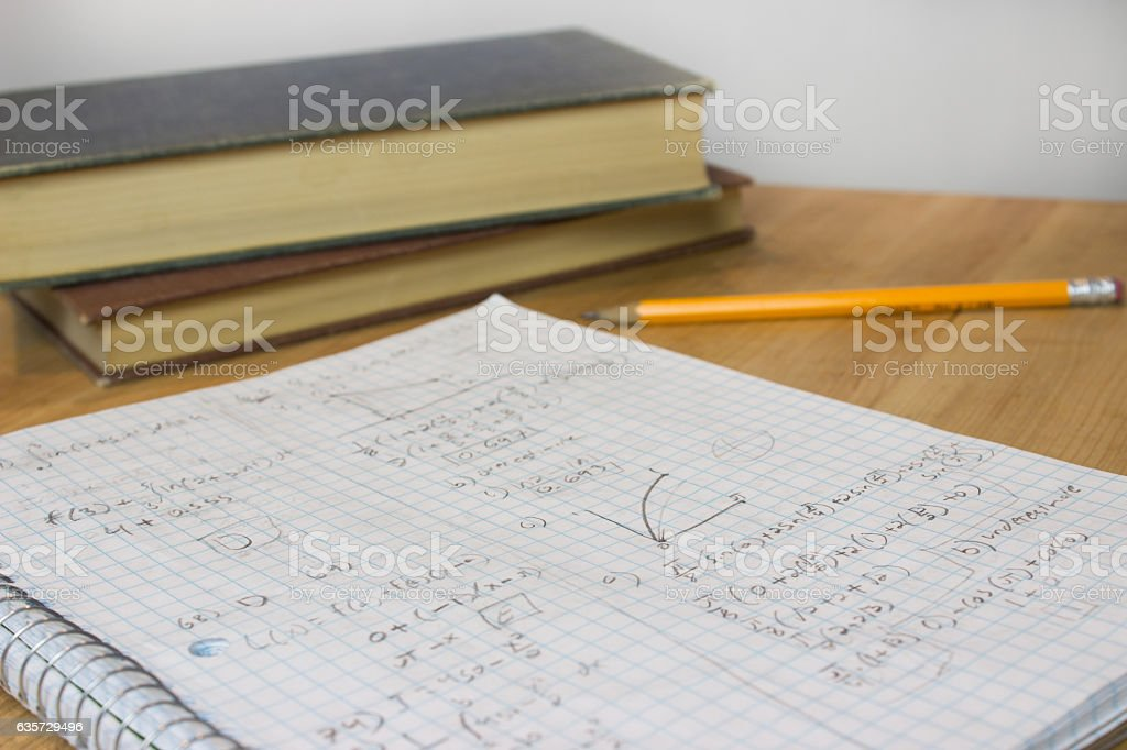 Math Homework with Pencil and Books stock photo