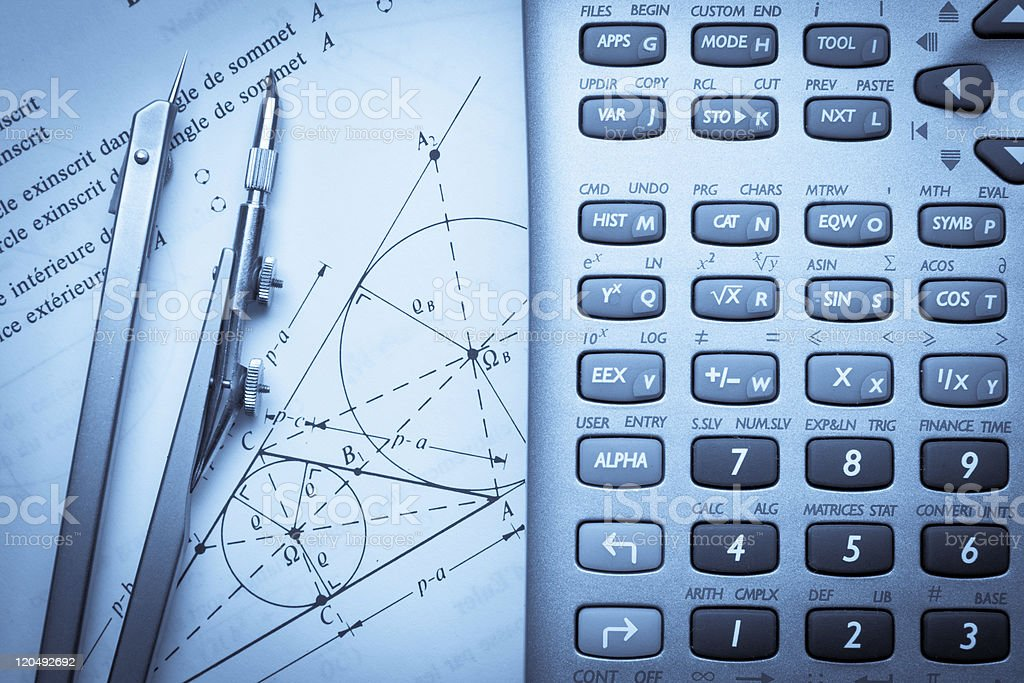 Math instructions with a compass and calculator stock photo