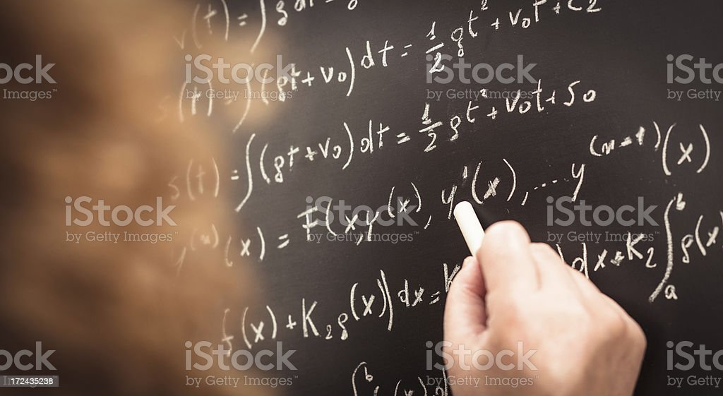 math teacher writing on the blackboard stock photo