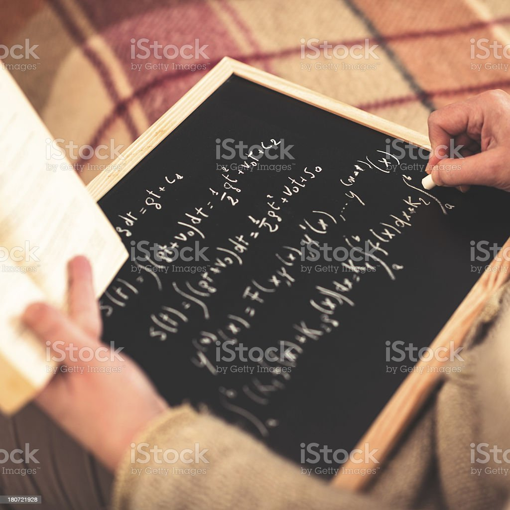 math teacher writing on the blackboard royalty-free stock photo