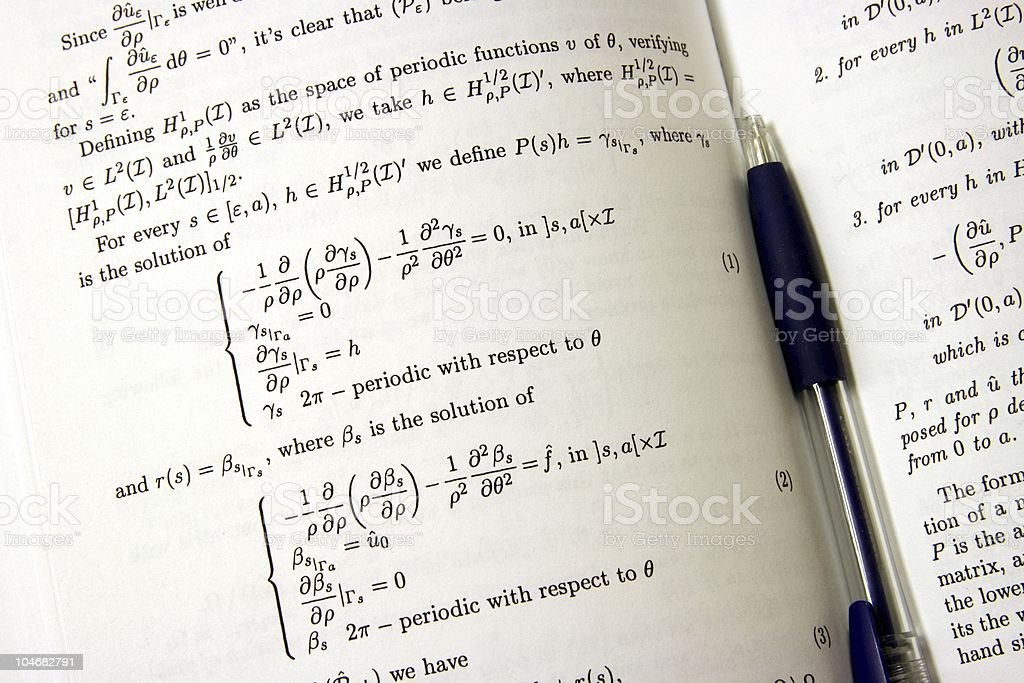 Mathematical book with pen royalty-free stock photo