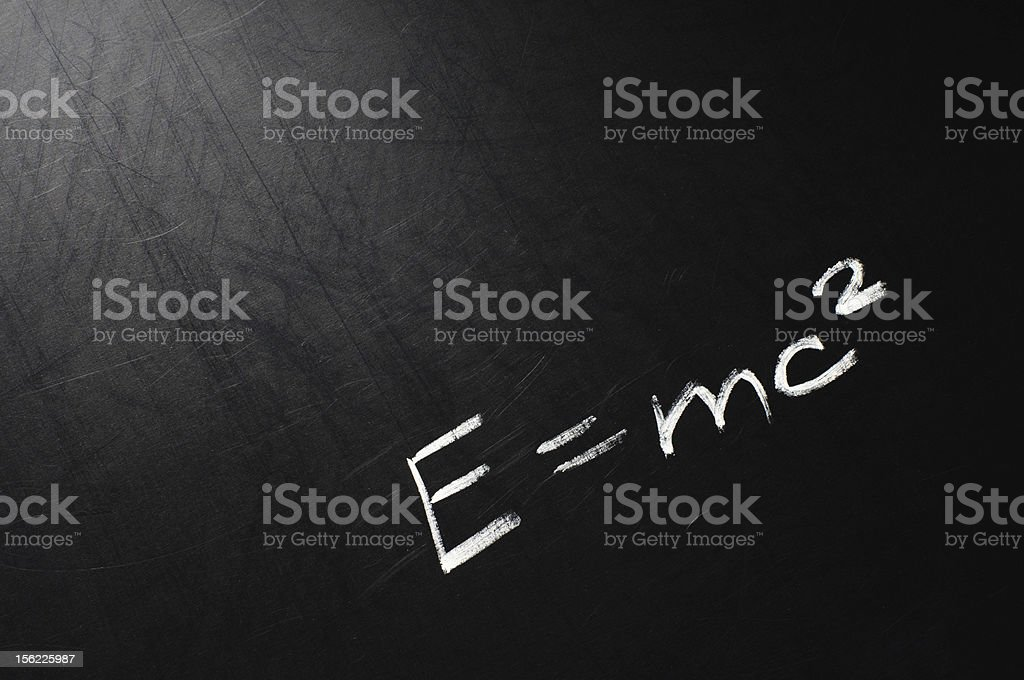 A mathematical equation on a chalkboard stock photo