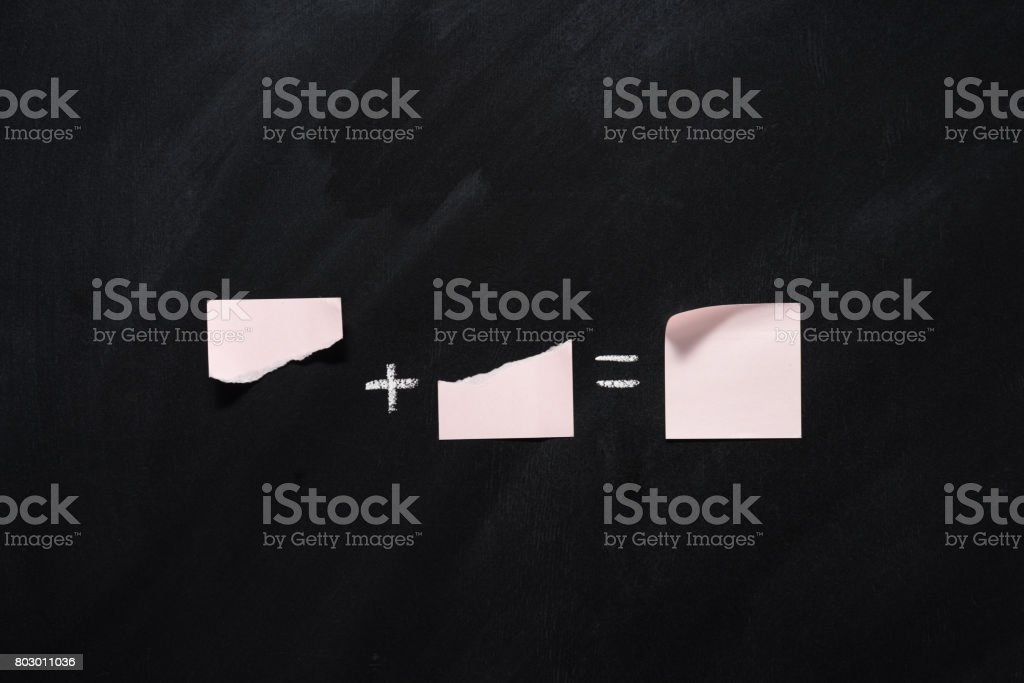 mathematical example made of blank notes on black chalkboard stock photo