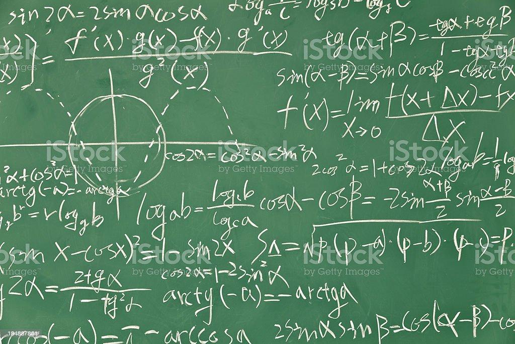 Mathematical formula on green blackboard stock photo
