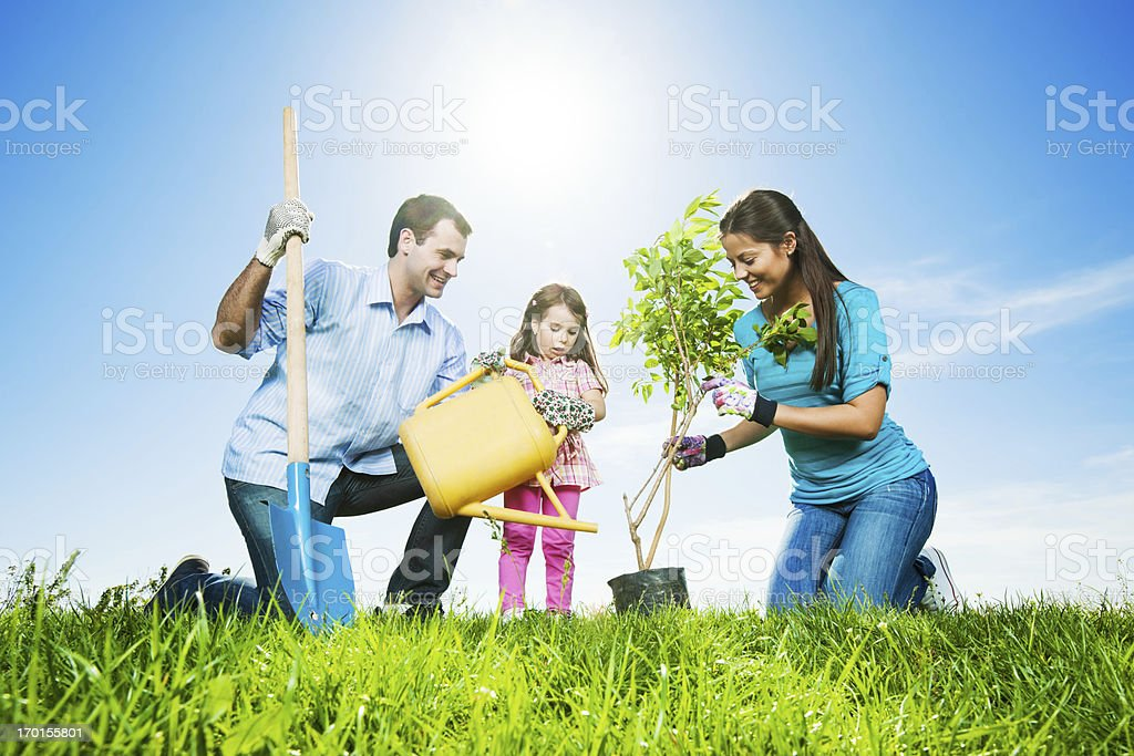 Mather, father and their daughter gardening on beautiful day royalty-free stock photo