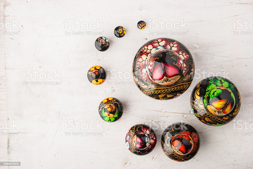 Matreshka set on the white wooden table stock photo