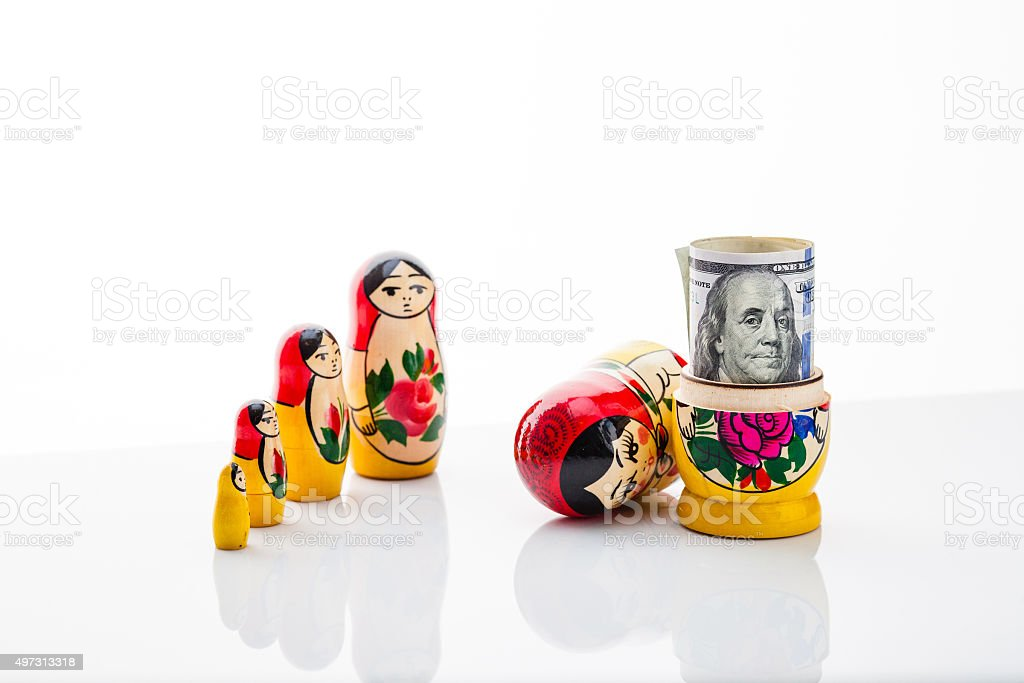 Matryoshka and bill hundred dollars stock photo