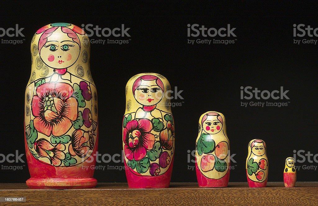 Matryoshka dolls set in a row on black background royalty-free stock photo