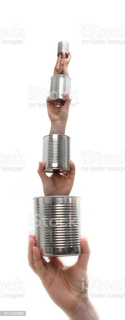 Matryoshka tins with hands stock photo