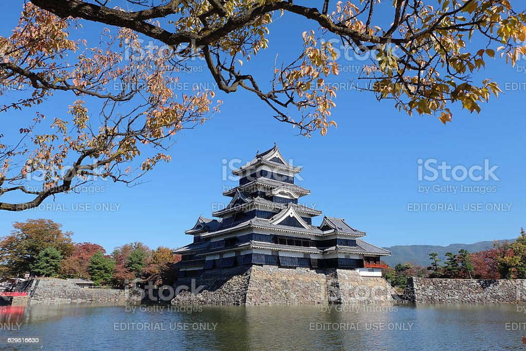 Matsumoto black castle with the reflection on the lake on the sunny day stock photo