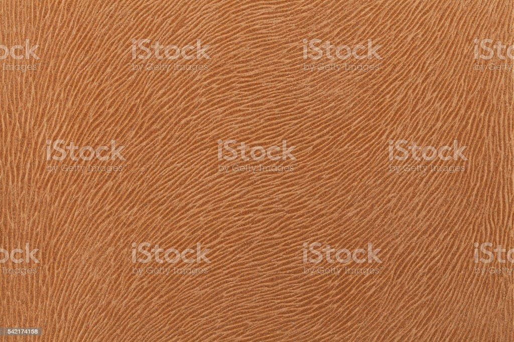 Matte brown fabric imitating animal fur. Leather background. Textured fabric. stock photo