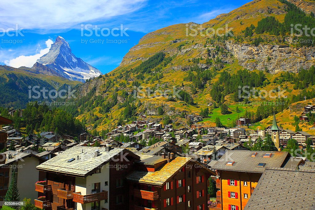 Matterhorn Above Zermatt alpine village swiss chalets panorama, Swiss Alps stock photo