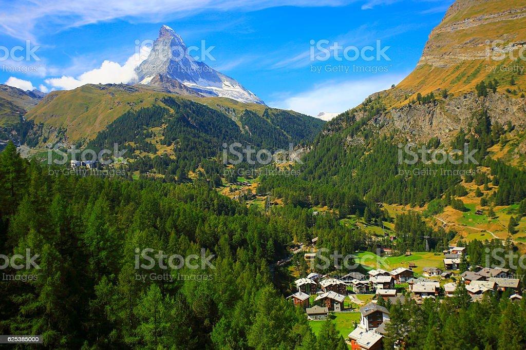 Matterhorn Above Zermatt alpine village swiss chalets panorama, Swiss Alps stock photo
