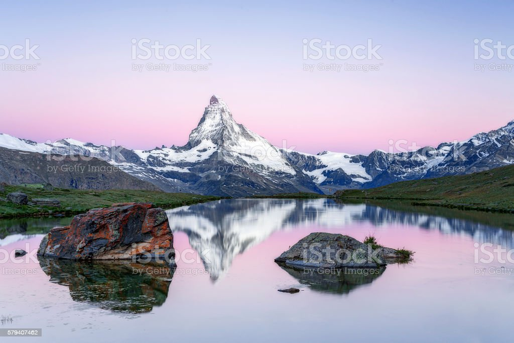 Matterhorn at sunrise with Stellisee in foreground stock photo