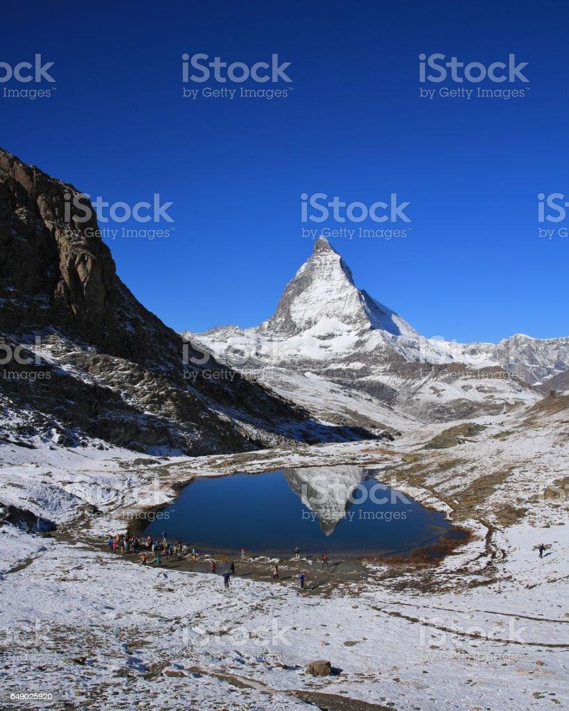 Matterhorn mirroring in lake Riffelsee stock photo