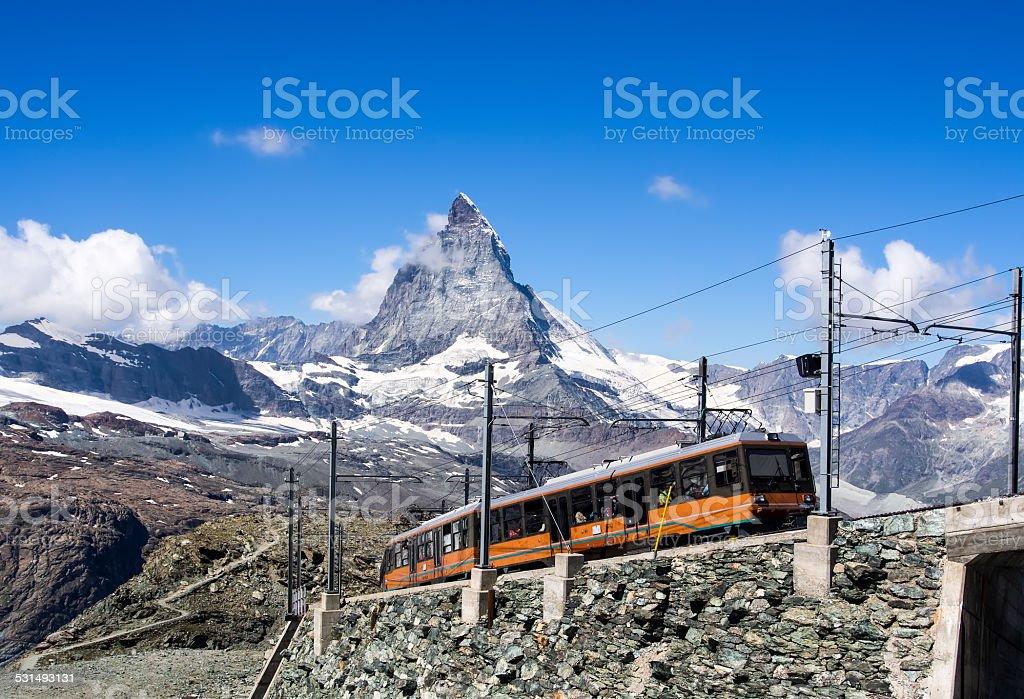 Matterhorn peak with a train , Switzerland stock photo