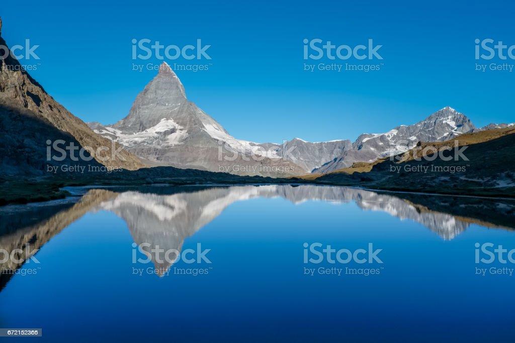 Matterhorn reflected in Lake  Riffelsee stock photo