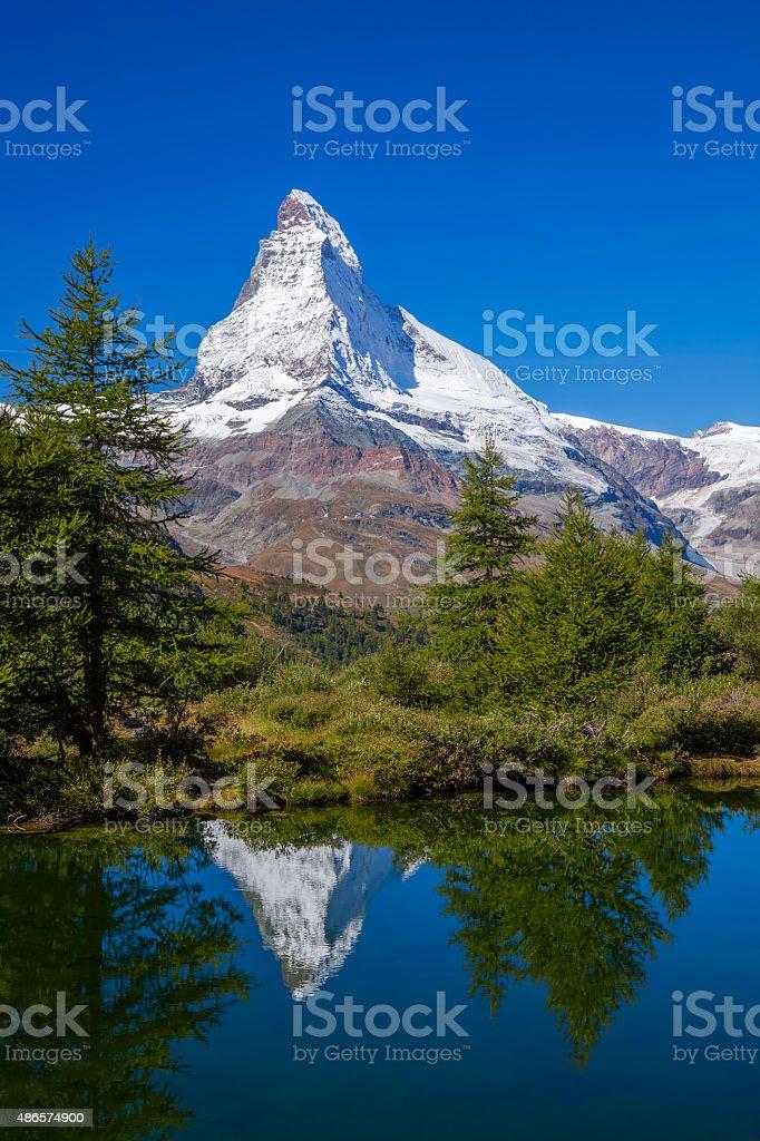 Matterhorn reflecting in Grindjisee in Swiss Alps, Switzerland stock photo