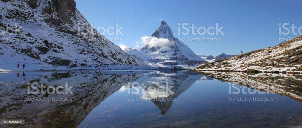 Matterhorn reflection from Riffelsee Lake, Switzerland stock photo