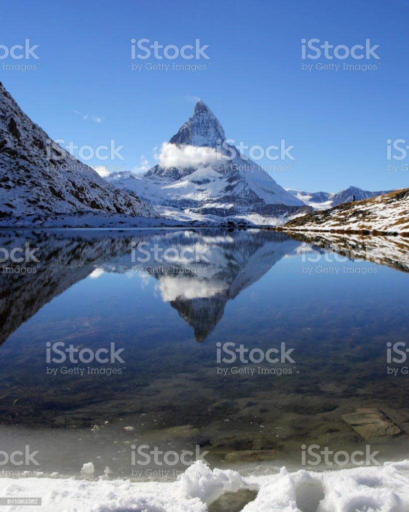 Matterhorn reflection on Riffelsee Lake, Switzerland stock photo