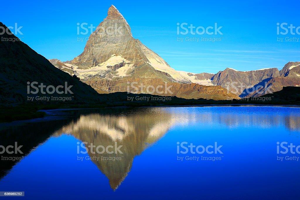 Matterhorn riffelsee lake reflection, swiss alps classic landscape stock photo